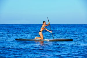 beginner standup paddleboard on knees paddling