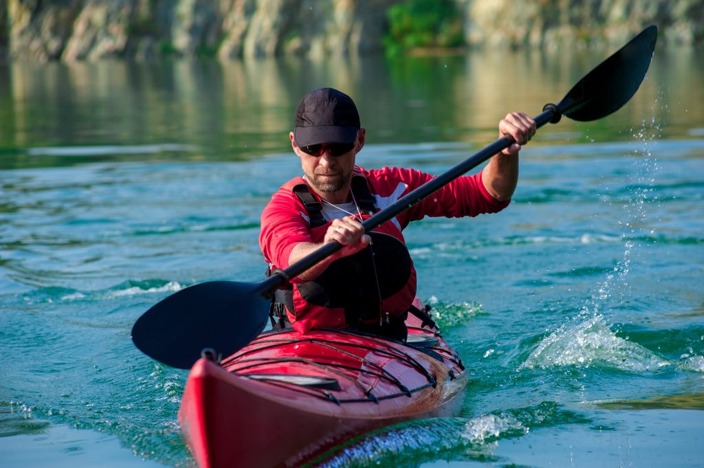 Man kayaking in beautiful scenery